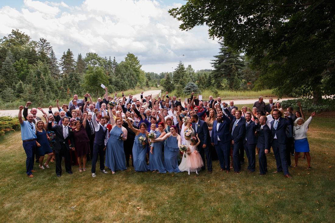 Large group photo of every that attended the wedding.